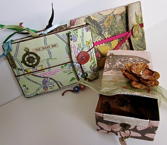 Two handmade books of pockets, and a handmade box.